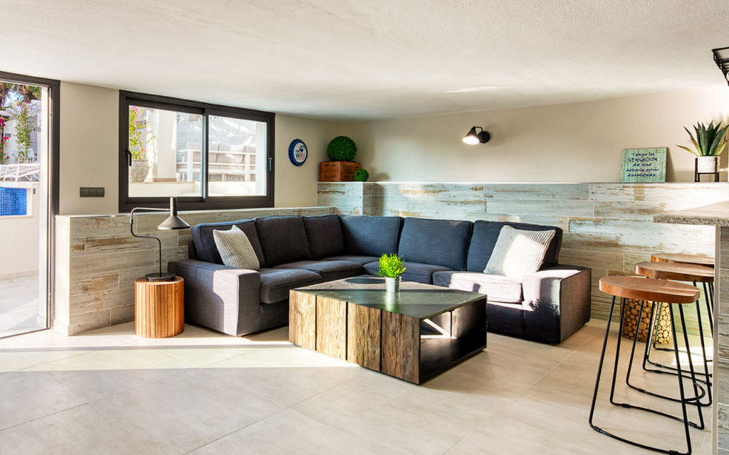 Contemporary indoor chill out space with green elements