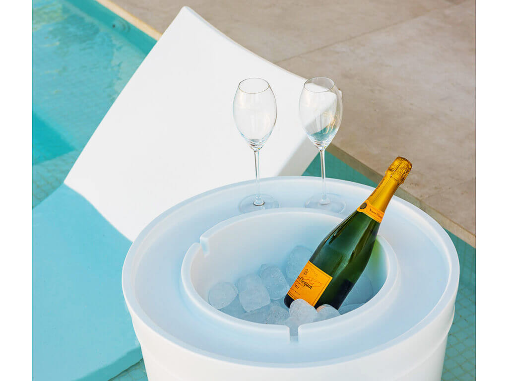 Luxurious in pool chair with side table and ice box imported and installed by ProMas