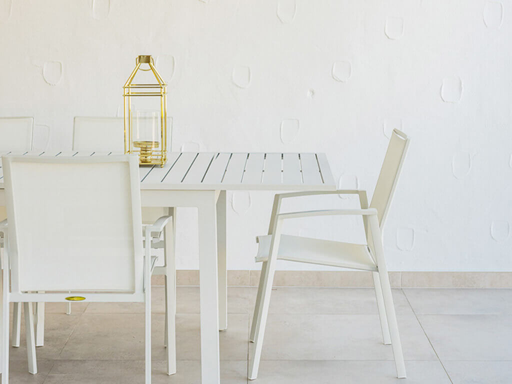 Stylish white designer outdoor living table and lantern designed by ProMas in Mijas