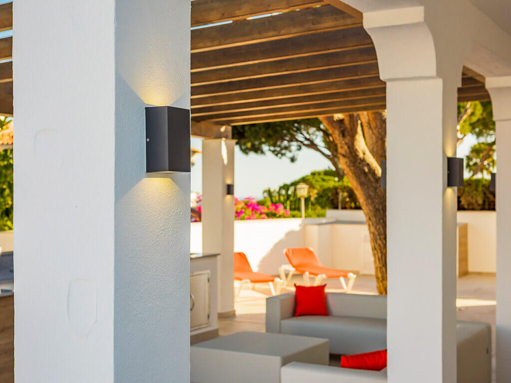 Looking through Spanish columns to modern chillout area in Costa del Sol