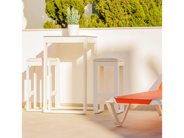 Bar table and stools with sun lounge designed by ProMas