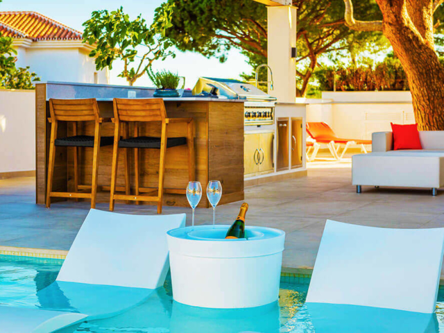 Stylish in pool relax chairs with outdoor kitchen and living in Mijas
