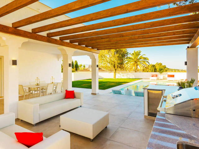 Stylish outdoor kitchen and living with pool relax zone designed and built by ProMas