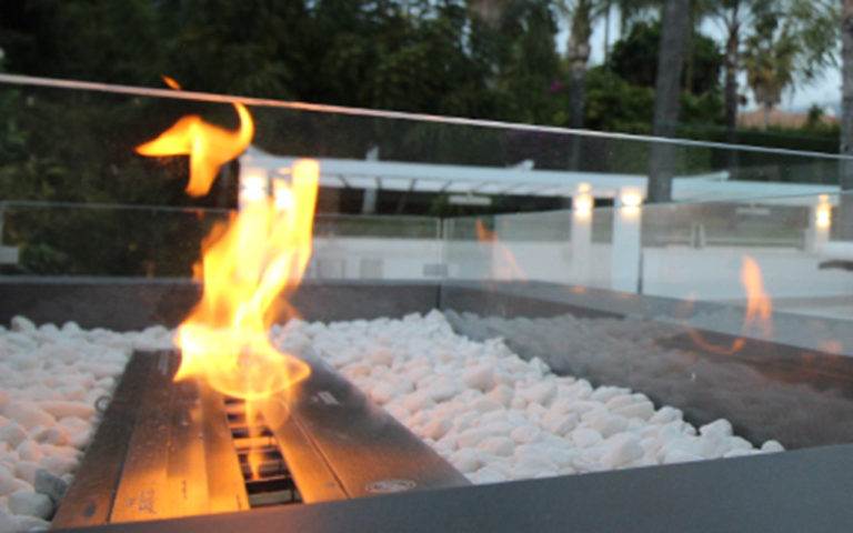 Stunning outdoor ethanal fireplace in chillout area on the Costa del Sol