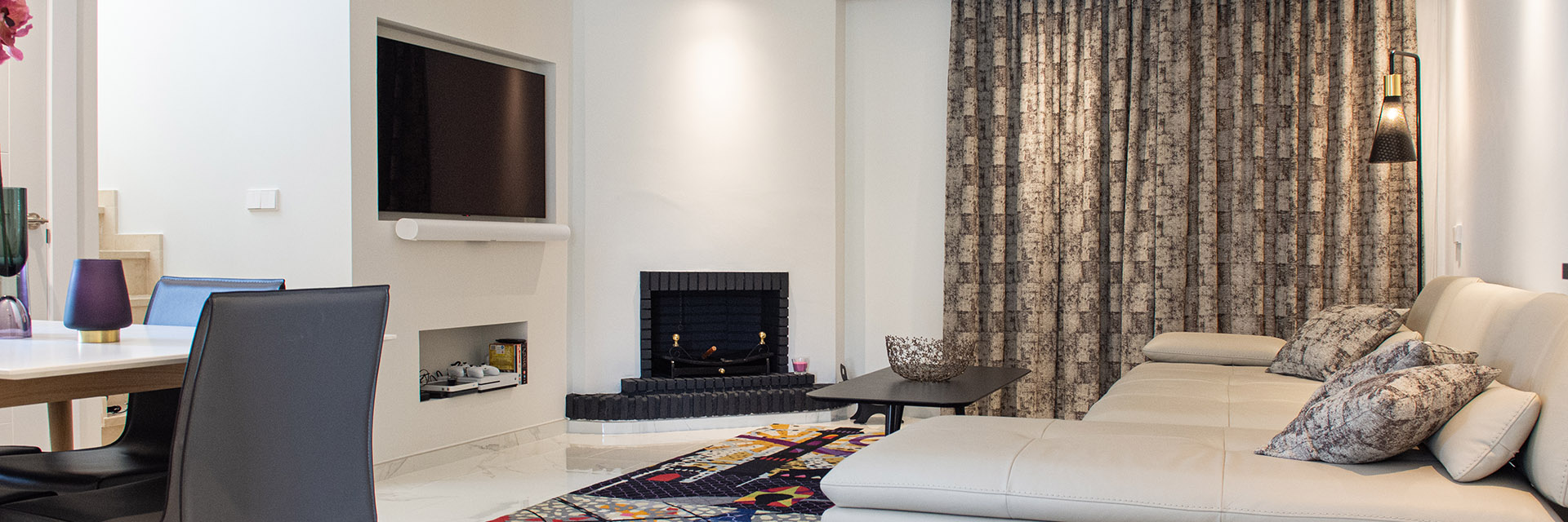 Refurbished living room with fireplace and built in television