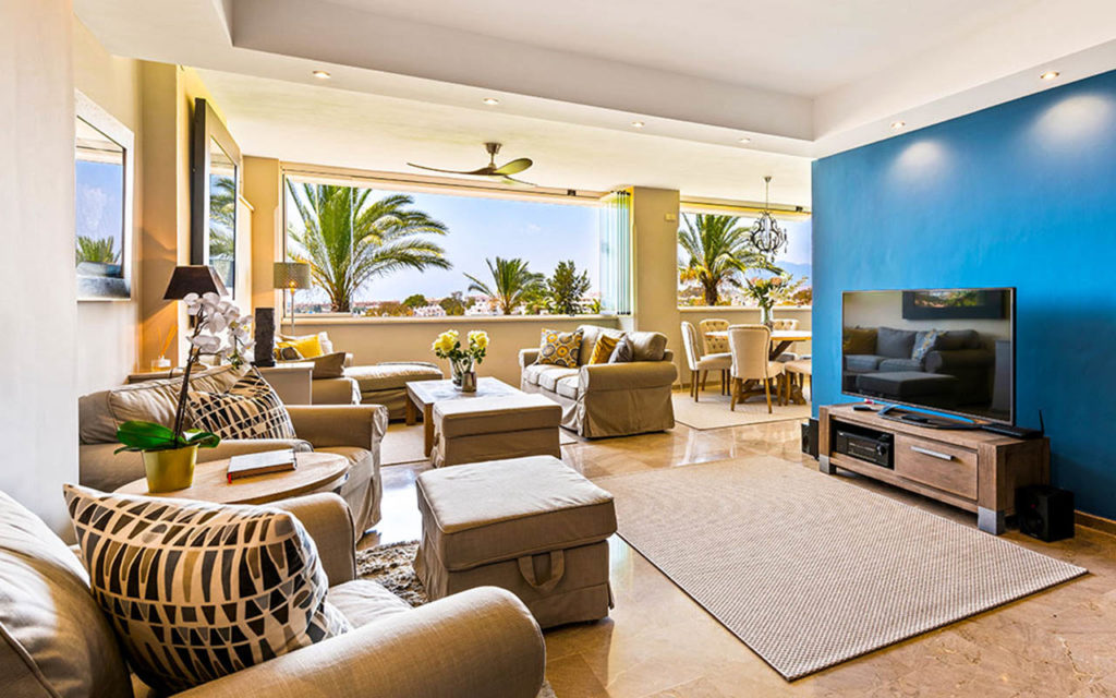 Contemporary living room with feature wall in Marbella