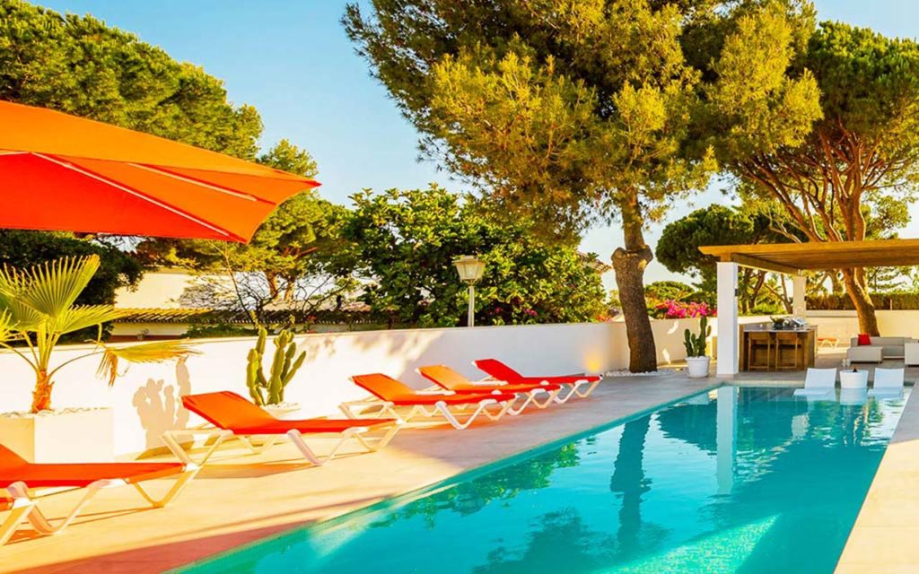 Stylish pool, with in water chairs and outdoor living area in Mijas