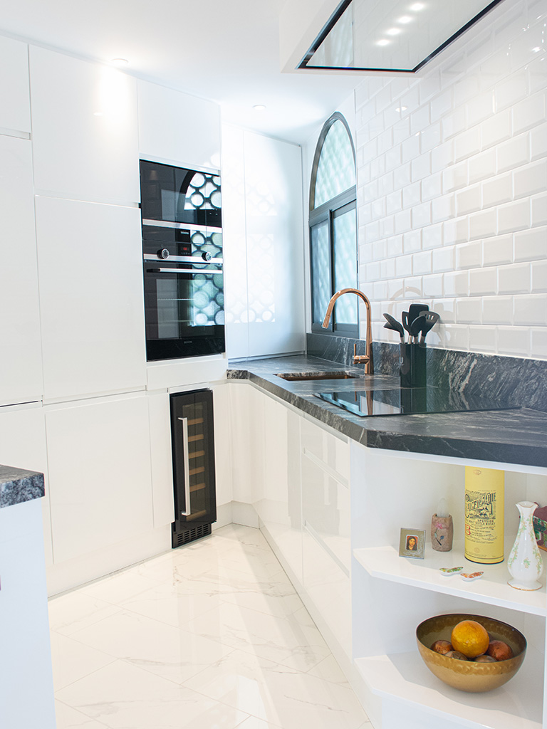 Stylish white and black corner kitchen design with wine fridge and open shelves
