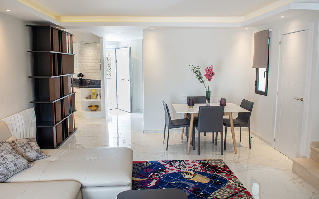 Refurbished living room with open kitchen