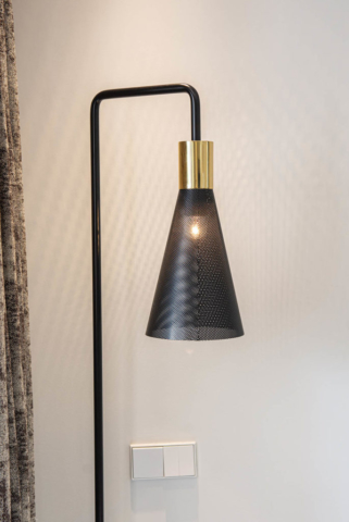 Contemporary black floor lamp and stylish interior design in Marbella