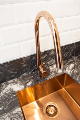 Stylish copper sink and black marble bench in Marbella
