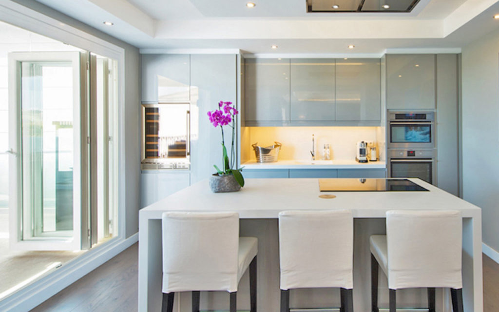 Stylish kitchen island with breakfast bar and grey tones