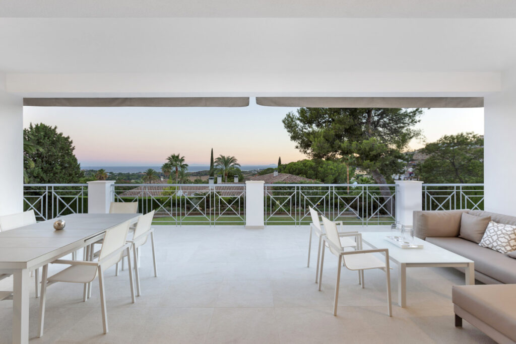 Stylish dinning and chillout area on balcony in Marbella
