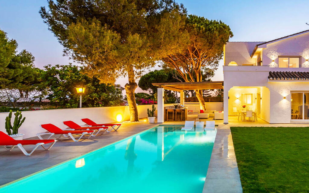 Stylish outdoor living area and pool with pergola and outdoor kitchen in Mijas Costa