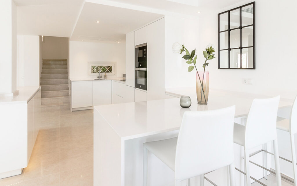 Stylish white kitchen in Buenavista, Marbella designed and built by ProMas