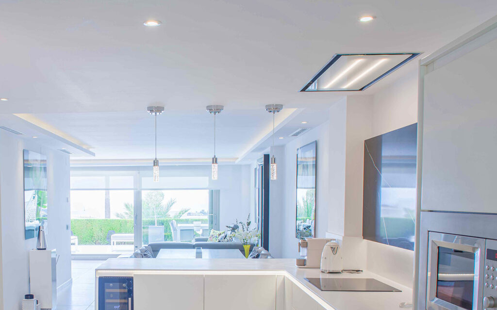 Combination of direct and indirect lighting in living room and kitchen