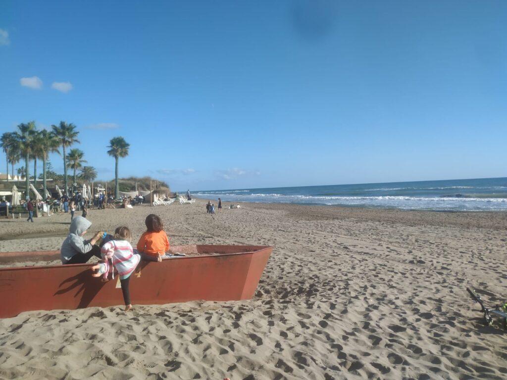 Children hanging out at Elviria beach
