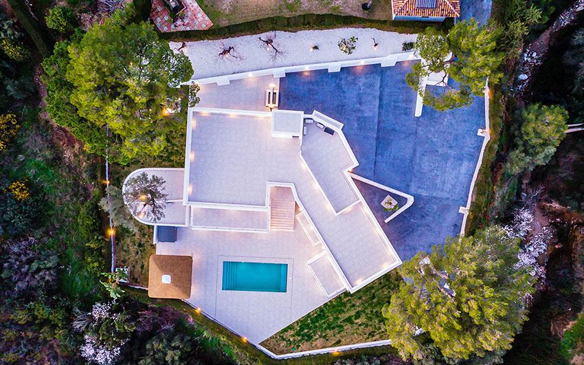 Ariel view of villa with outdoor lighting