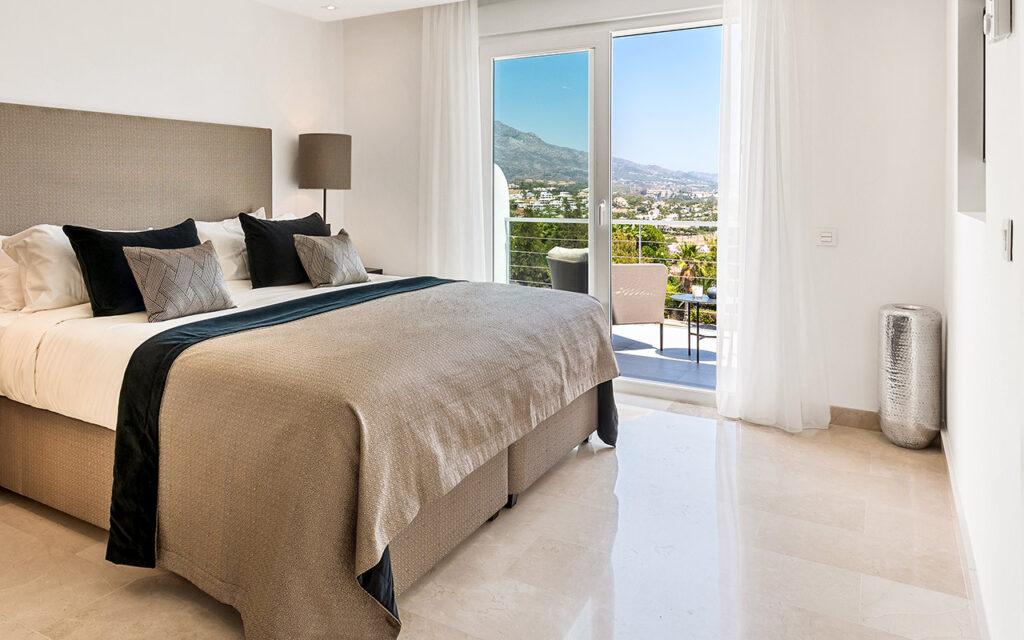 Beige polished stone floors in bedroom
