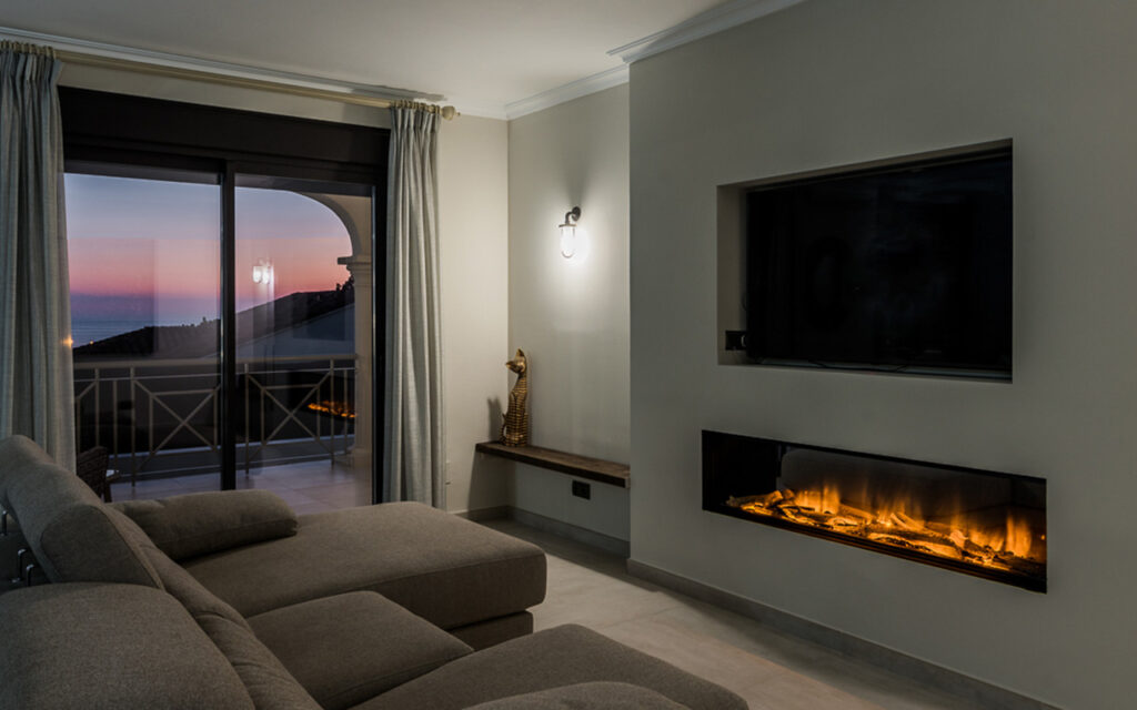 Renovated room with fireplace by ProMas