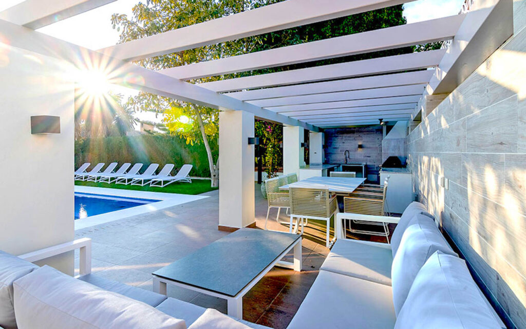 Poolside outdoor kitchen and chill out area designed and installed by ProMas